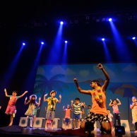 Instructor Krishna Lohra on stage with our favorite age group, Mississauga Kids!