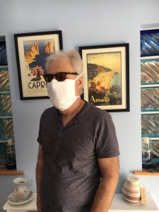"""A 60 year old man wears a home-made, """"no-sew"""" mask made in order to safely visit a Cancer ward for essential blood tests"""